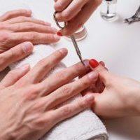 bigstock-Men-s-Manicure-Woman-Beautici-244140838