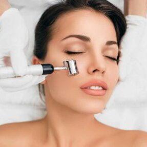 bigstock-Woman-Getting-Procedure-Facial-282709354