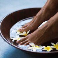 bigstock-Woman-soaking-feet-in-bowl-of--256245799